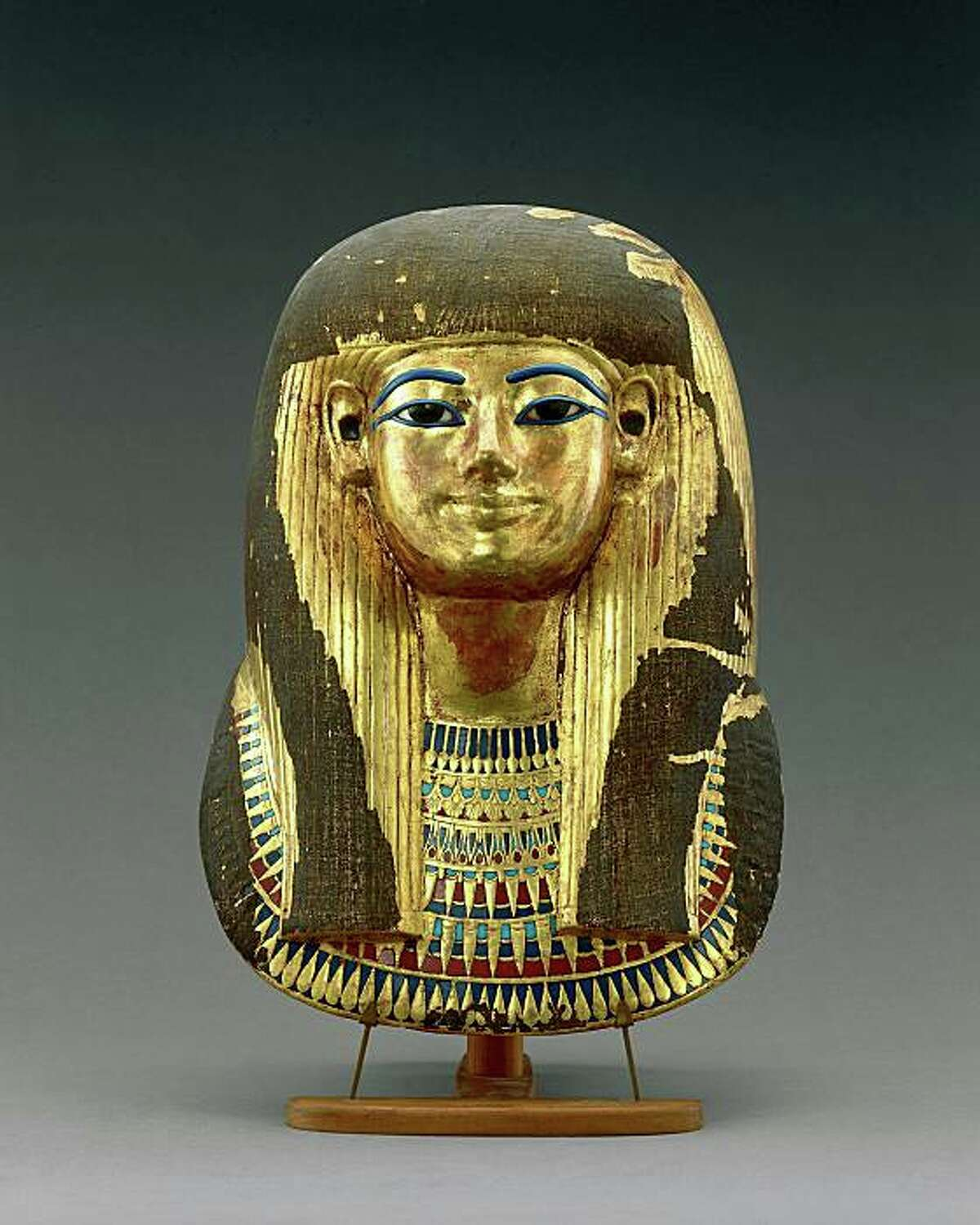 Tutankhamun and the Golden Age of the Pharaohs. Gilded Funerary Mask of Tijuya. Dynasty 18, reign of Amenhotep III (1390-1353 BC) Gilded cartonnage. Egyptian Museum, Cairo.