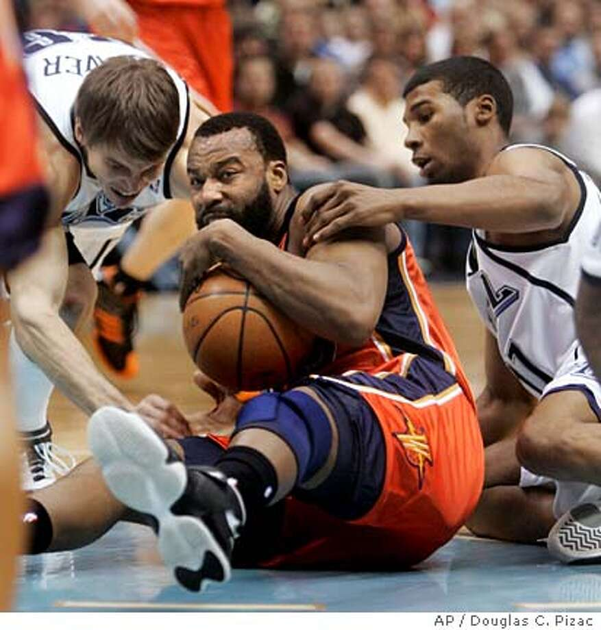 Utah Jazz forward Kyle Korver, left, and guard Ronnie Price grapple with Golden State Warriors guard Baron Davis (5) for the ball during the second quarter of the NBA basketball game Tuesday, Feb. 19, 2008, in Salt Lake City. (AP Photo/Douglas C. Pizac) Photo: Douglas C. Pizac