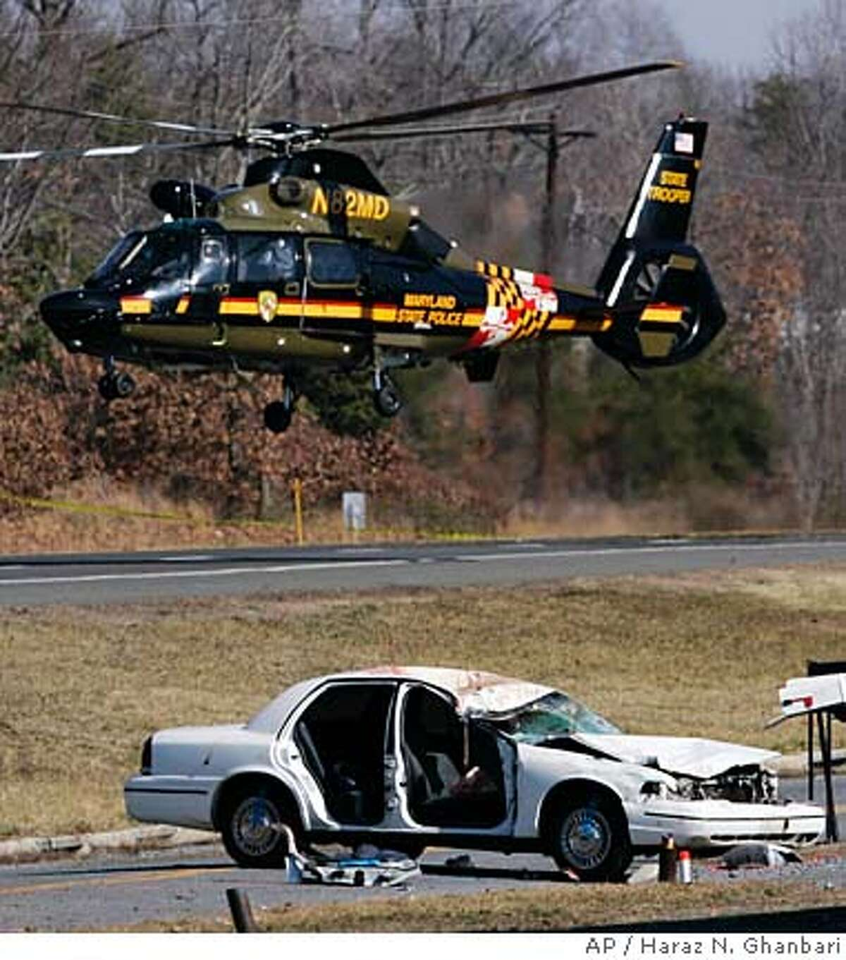 A Maryland State Police helicopter takes off from the scene of a car crash on Indian Head Highway, Saturday, Feb. 16, 2008, in Accokeek, Md. A car plowed into a crowd that had gathered to watch a drag race on the suburban road early Saturday, killing seven people and injuring at least four, police said. (AP Photo/Haraz N. Ghanbari)