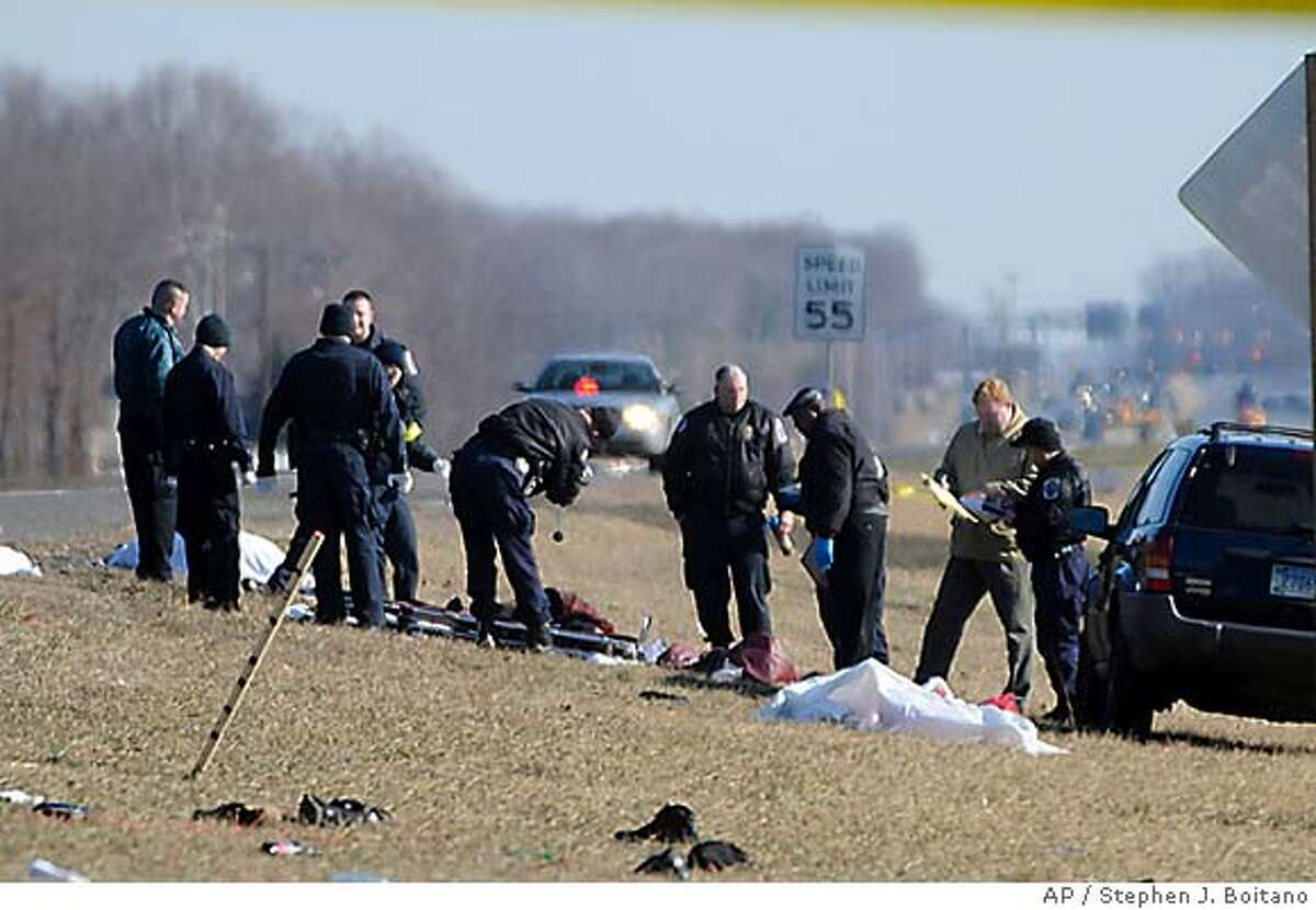 Police investigate the scene in an accident on Route 210 in Accokeek, Md., where authorities said a car plowed into a crowd that apparently gathered to watch a drag race on the suburban road early Saturday, Feb. 16, 2008, killing seven people and injuring at least four. (AP Photo/Stephen J. Boitano)