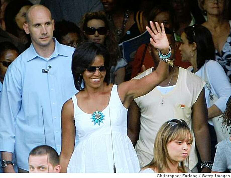 US First Lady Michelle Obama waves to tourists as she leaves the Colosseum after a private tour of the ancient monument on July 8, 2009 in Rome, Italy. The wives of the leaders attending the G8 summit have visited many of the attractions of Rome whilst their husbands discuss world issues in L'Aquila.  Photo: Christopher Furlong, Getty Images
