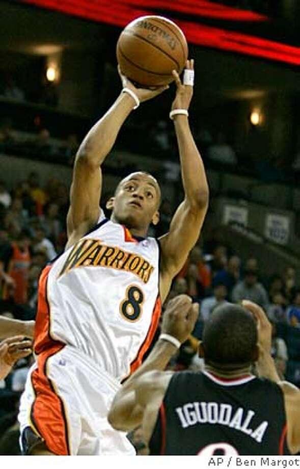 Golden State Warriors' Monta Ellis (8) shoots over Philadelphia 76ers' Andre Iguodala in the first half of an NBA basketball game Friday, Feb. 29, 2008, in Oakland, Calif. (AP Photo/Ben Margot) Photo: Ben Margot