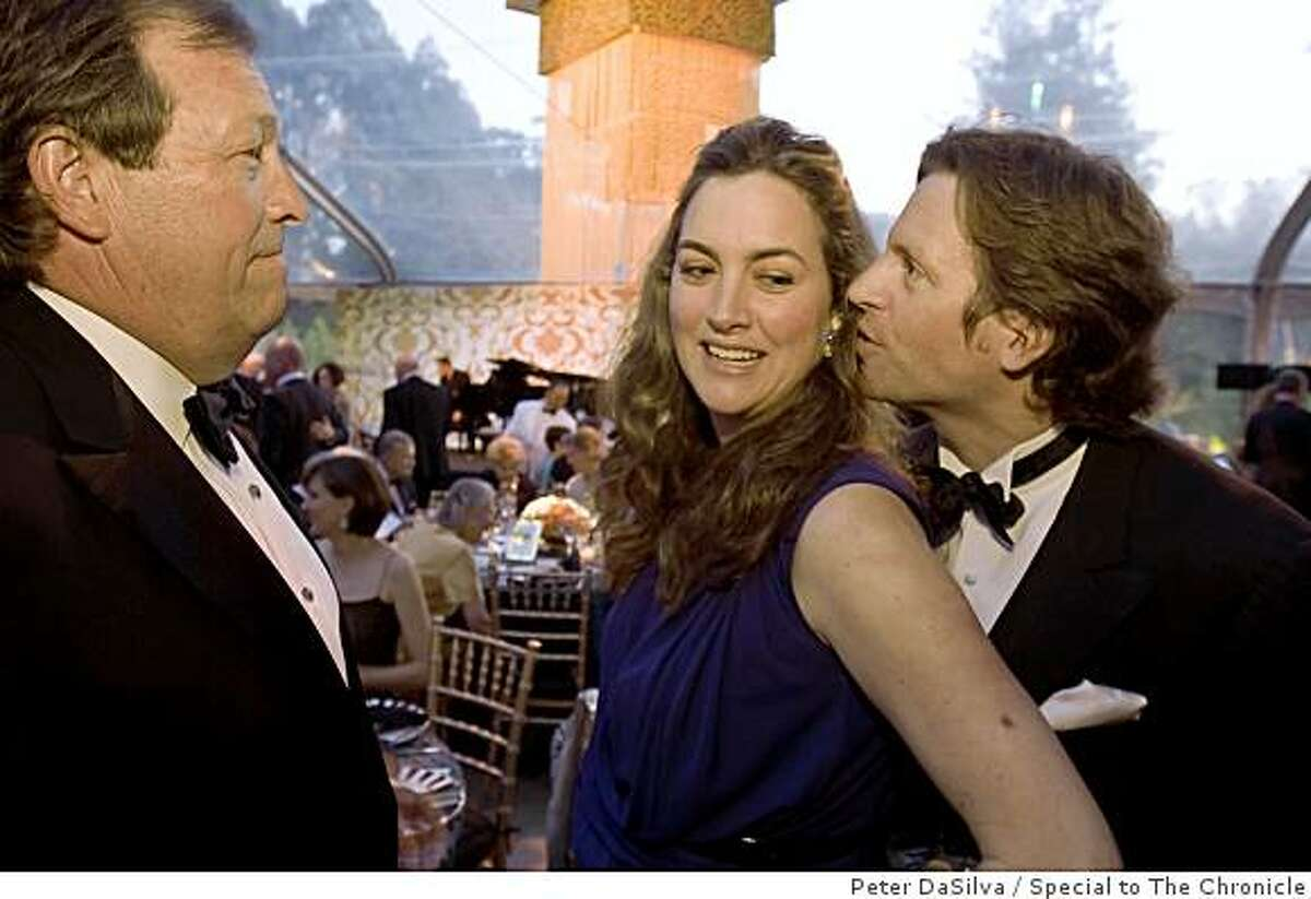 Guests Doug Biederbeck, Alexis Swanson Traina and husband Trevor Traina of the Tutankhamun and the Golden Age of the Pharaohs opening gala, chat in the dinner tent after touring the Tutankhamun exhibit at the de Young Museum in San Francisco, California on Jun. 23, 2009.