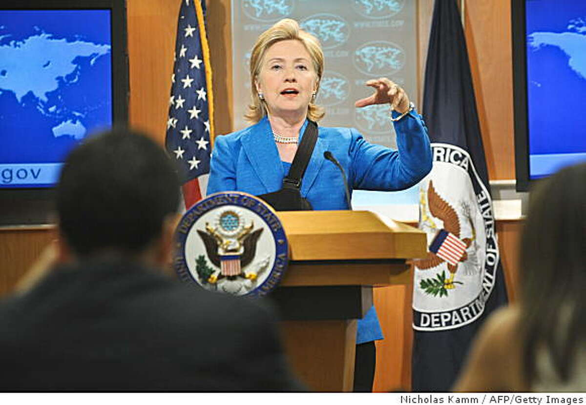 US Secretary of State Hillary Clinton speaks to the press after meeting with ousted Honduran President Manuel Zelaya at the State Department in Washington on July 7, 2009. AFP PHOTO/Nicholas KAMM (Photo credit should read NICHOLAS KAMM/AFP/Getty Images)