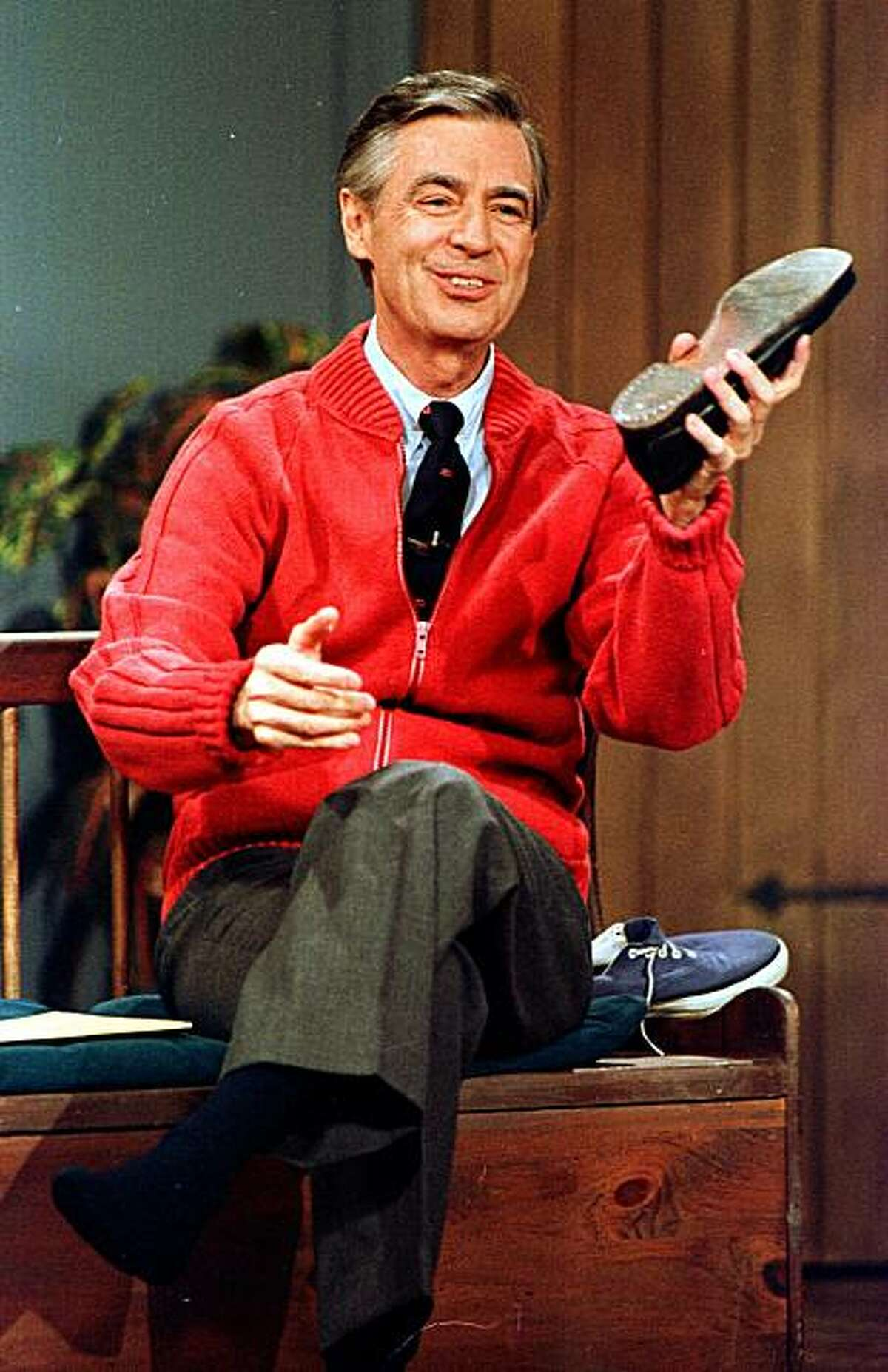 ** FILE ** Fred Rogers rehearses the opening of his PBS show