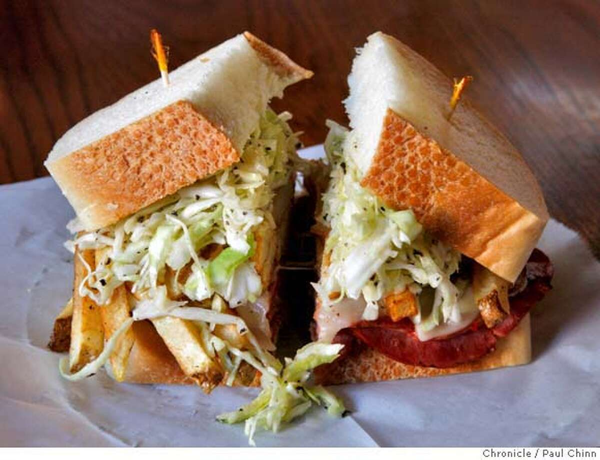 The all-in-one sandwich consists of olive oil and vinegar slaw, french fries, provolone cheese and your choice of grilled meats at Giordano Bros. sandwich shop in San Francisco, Calif. on Saturday, Feb. 16, 2008. PAUL CHINN/San Francisco Chronicle