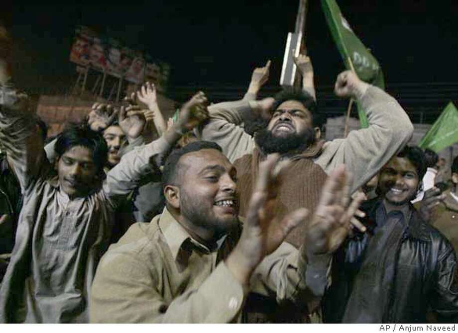 Supporters of the party of Pakistan's former prime minister Nawaz Sharif celebrate the primary unofficial results for Pakistan's general elections in the street of Rawalpindi, Pakistan, on Monday, Feb. 18, 2008. Pakistanis voted Monday for a new parliament in elections shadowed by fears of violence and questions about the political survival of President Pervez Musharraf, America's key ally in the war on terror. (AP Photo/Anjum Naveed) Photo: Anjum Naveed