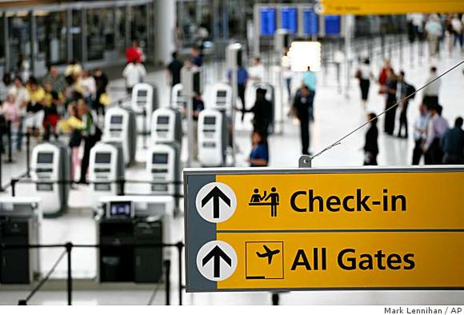 The ticketing and check-in area is shown at JetBlue Airways' new Terminal 5 at John F. Kennedy International Airport on Saturday, Aug. 23, 2008 in New York. (AP Photo/Mark Lennihan) Photo: Mark Lennihan, AP