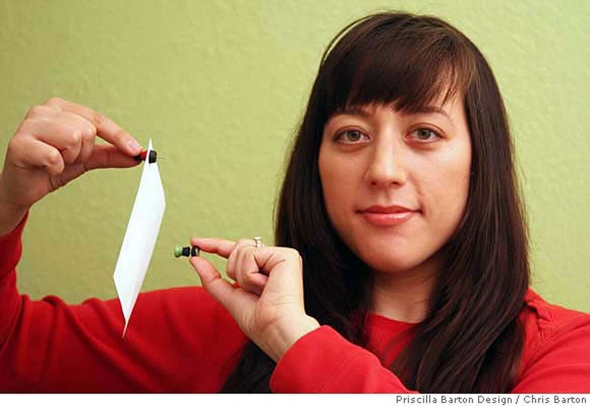 Berkeley designer Priscilla Barton, a graduate of the California College of the Arts in San Francisco demonstrates the magnetic pushpin she designed for a student competition and later licensed to OXO, a homewares manufacturer that will also distribute it in March.