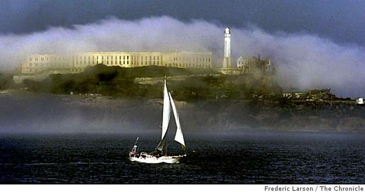 ALCATRAZ-05FEB01-SZ-FRL: Alcatraz Island topped with morning fog inSF as mostly sunny skies took over the Bay Area for a pleasant spring like day. Chronicle photo by Frederic Larson.