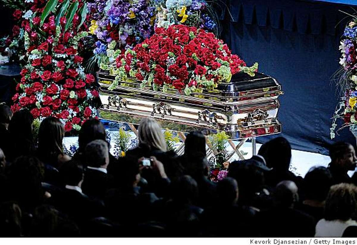 LOS ANGELES, CA - JULY 07: Michael Jackson's casket is brought out during public memorial service held at Staples Center on July 7, 2009 in Los Angeles, California. Jackson, 50, the iconic pop star, died at UCLA Medical Center after going into cardiac arrest at his rented home on June 25 in Los Angeles, California. (Photo by Kevork Djansezian/Getty Images)