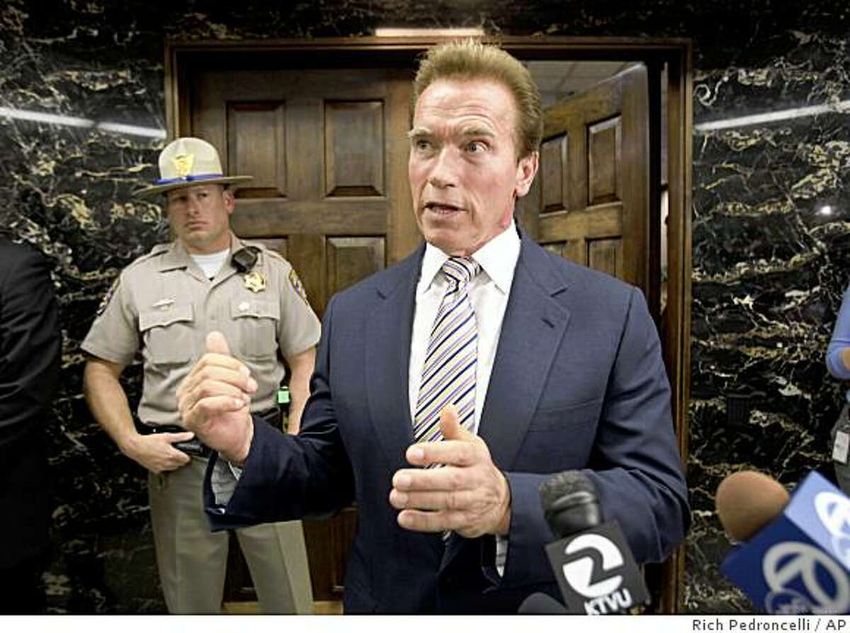 Gov. Arnold Schwarzenegger talks to reporters about the state's pending cash crisis at the Capitol in Sacramento, Calif., Friday, June 26, 2009. State Controller John Chiang has warned that California will be forced to issue IOU's instead of payments next week unless Schwarzenegger and state lawmakers can come up with a solution to the state's $24.3 billion deficit.(AP Photo/Rich Pedroncelli)