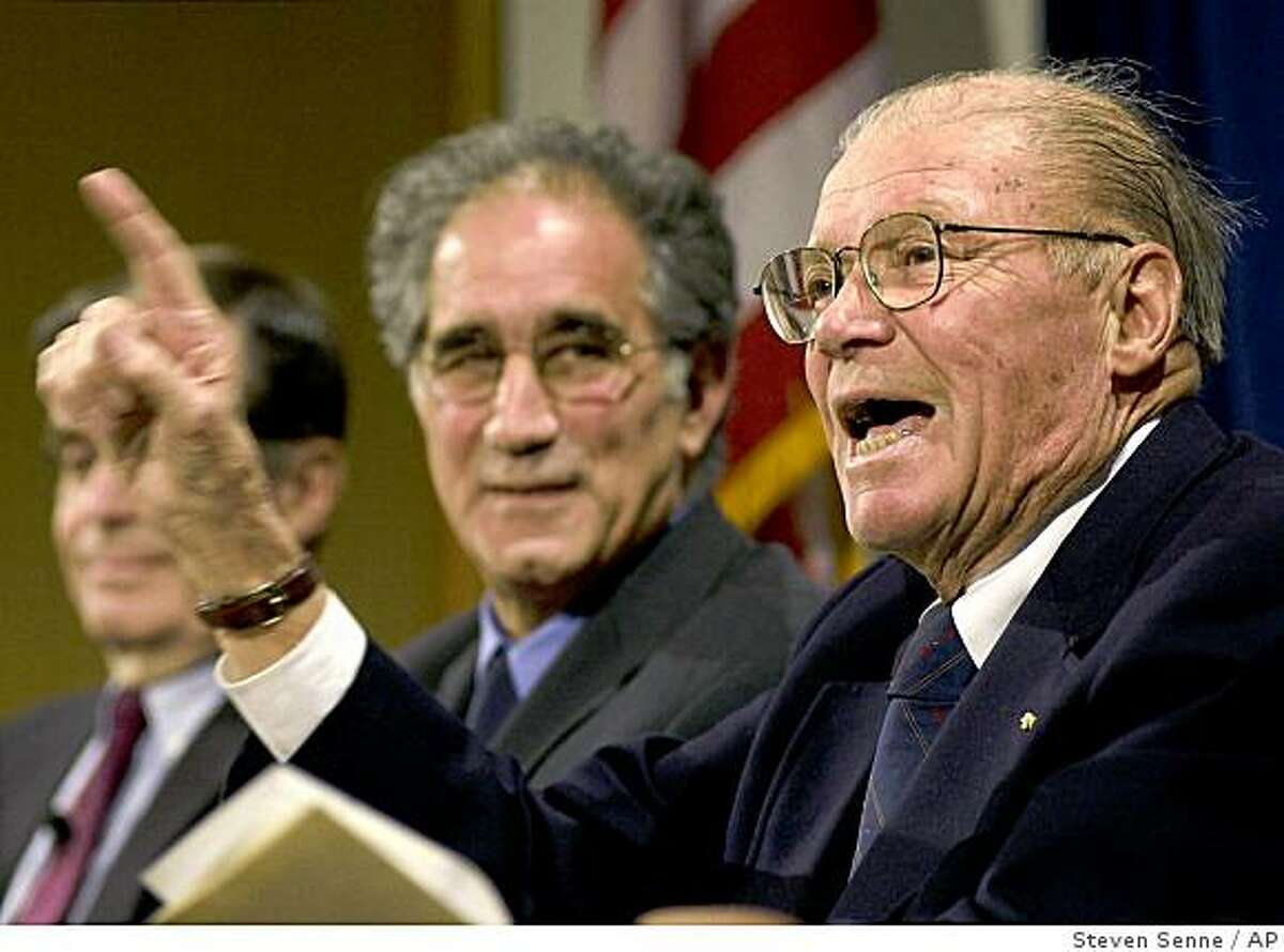 FILE - In a Wednesday, Feb. 21, 2001 file photo, Robert McNamara, right, defense secretary under Presidents Kennedy and Johnson, makes a point as Peter Almond, center, co-producer of the film