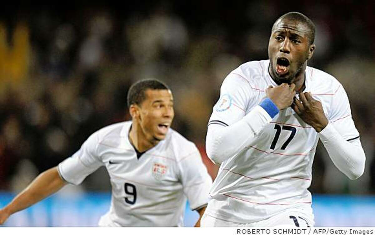 US forward Jozy Altidore (L) celebrates with US forward Charlie Davies after scoring the first goal during the Fifa Confederations Cup semi-final football match Spain against the United States on June 24, 2009 at the Freet State stadium in Bloemfontein. AFP PHOTO / ROBERTO SCHMIDT (Photo credit should read ROBERTO SCHMIDT/AFP/Getty Images)