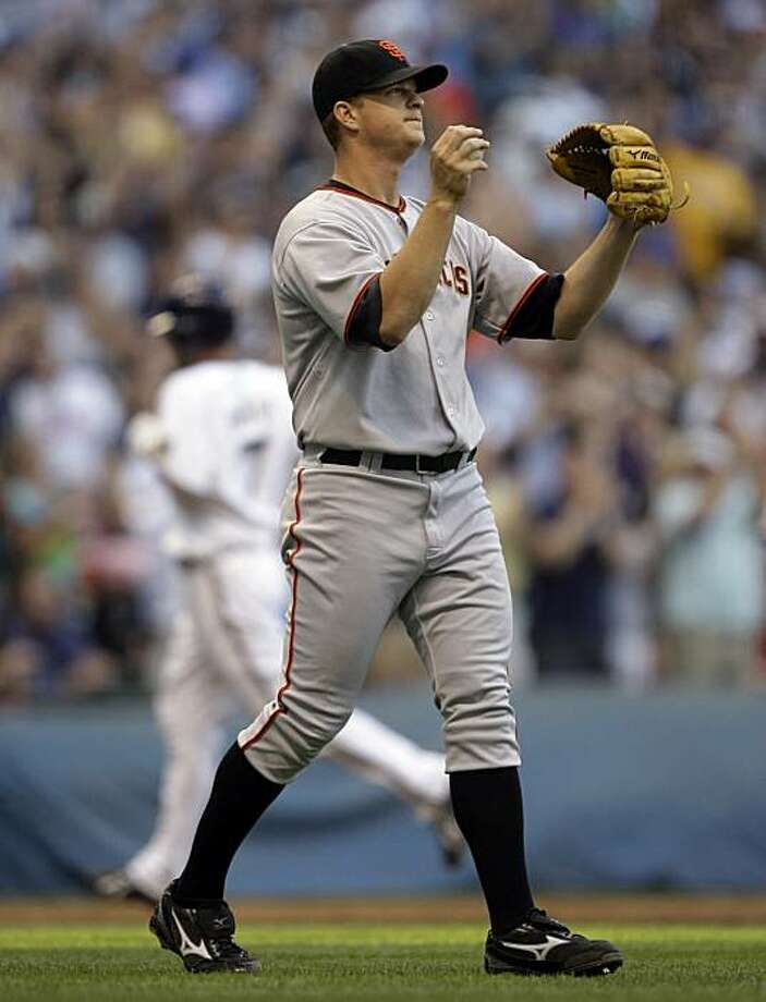 San Francisco Giants starting pitcher Matt Cain reacts after Milwaukee Brewers' J.J. Hardy (7), background, hit a home run during the third inning of a baseball game Friday, June 26, 2009, in Milwaukee. (AP Photo/Morry Gash) Photo: Morry Gash, AP