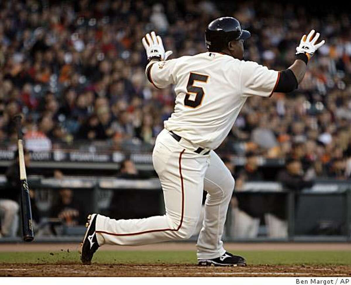 San Francisco Giants' Juan Uribe drops his bat after hitting a two-run home run off Florida Marlins' Josh Johnson in the fifth inning of a baseball game Tuesday, July 7, 2009, in San Francisco.