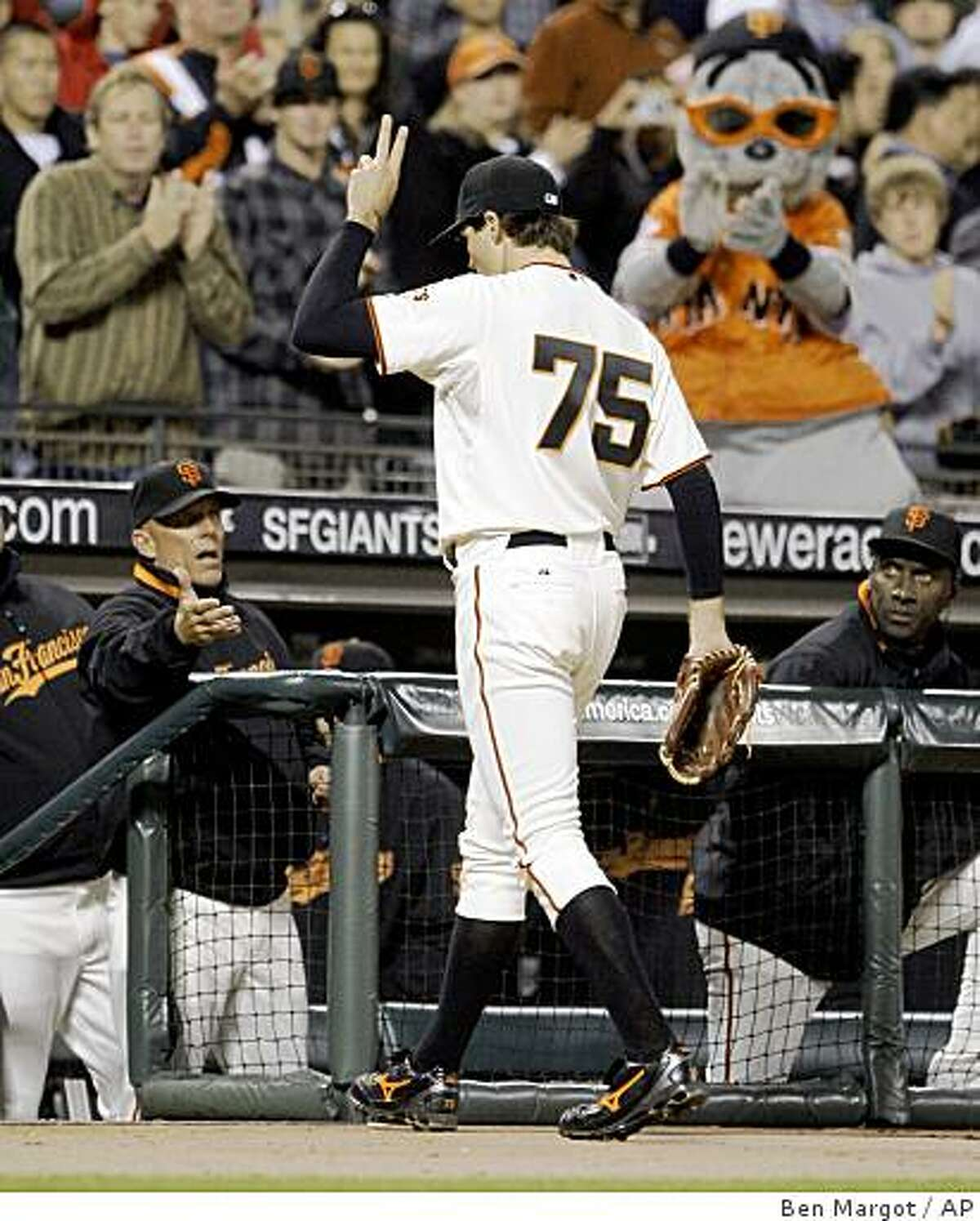 San Francisco Giants' Barry Zito gestures to fans as he leaves the baseball game against the Florida Marlins during the ninth inning Tuesday, July 7, 2009, in San Francisco. (AP Photo/Ben Margot)