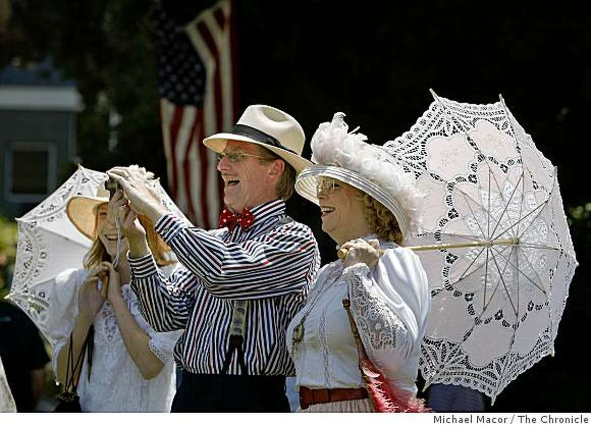Chuck Linsley, (center) takes a photograph with, well not exactly a Kodak Brownie camera, as he is joined by daughter Sara, (left) and wife Carey, during the Old Fashioned 1908 Patriotic Picnic at the Historic Pardee Home in downtown Oakland, Calif. on Saturday July 4, 2009. tHe Linsley family is from San JOse.