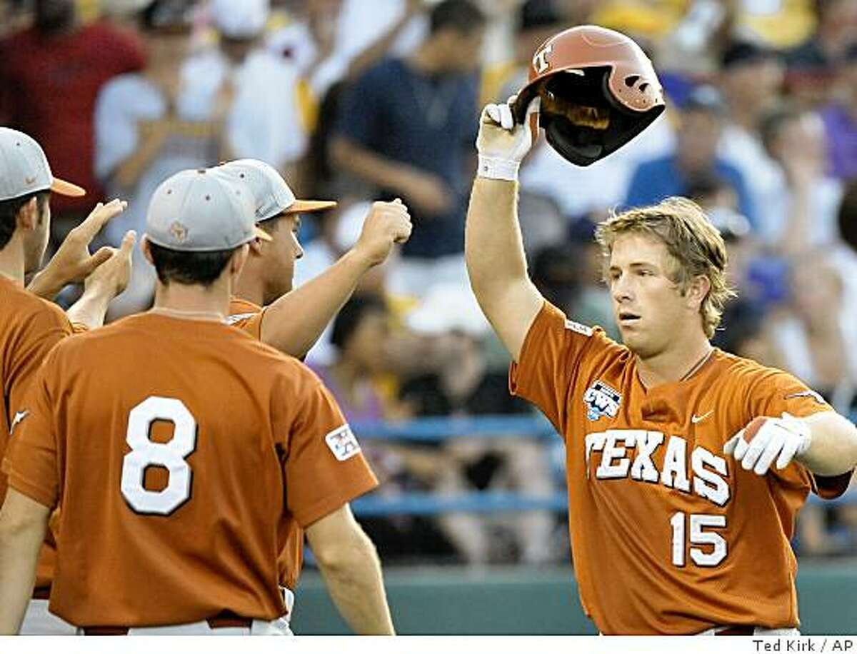Texas' Russell Moldenhauer (15) celebrates his home run against LSU in the third inning of Game 2 of the NCAA College World Series best-of-three baseball finals, in Omaha, Neb., Tuesday, June 23, 2009.(AP Photo/Ted Kirk)