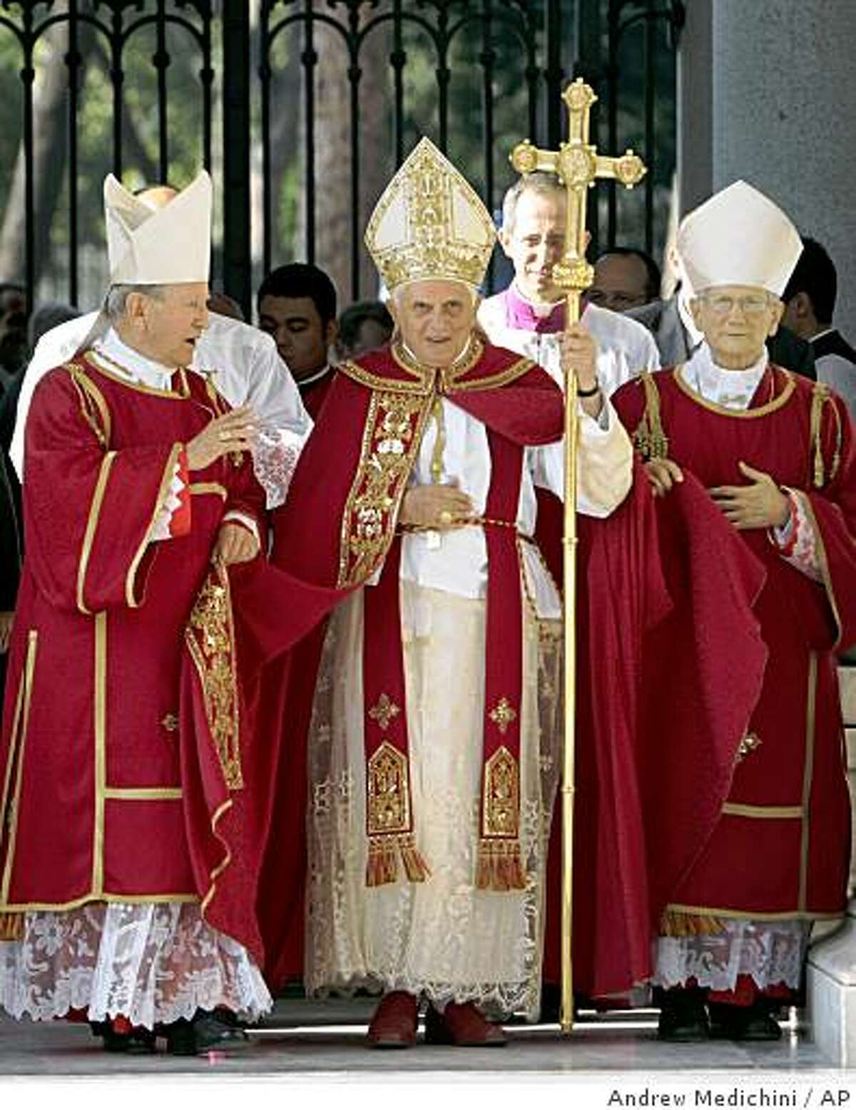 Pope Benedict XVI, at center, arrives with other prelates for a solemn vespers service for St. Peter and St. Paul, in St. Paul Outside the Walls Basilica, in Rome, Sunday, June 28, 2009. The pontiff said recent scientific tests on what are believed to be the remains of the Apostle Paul