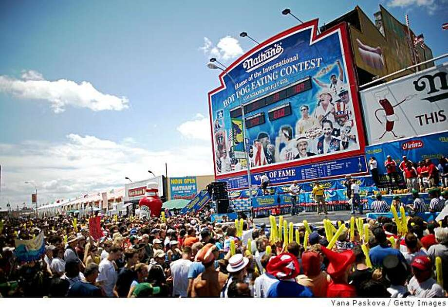 A crowd gathers before the Nathan's Famous Fourth of July hot dog eating contest begins on July 4, 2009 in Coney Island in the Brooklyn borough of New York City. Joey Chestnut of San Jose, California defeated Takeru Kobayashi of Nagano, Japan with eating 68 to his 64.5 hotdogs. Kobayashi won six previous competitions before tying last year with Chestnut. Photo: Yana Paskova, Getty Images