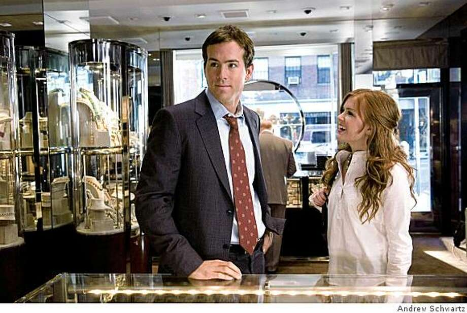 Will Hayes (RYAN REYNOLDS) attempts to romance the apolitical April (ISLA FISHER) in a romantic comedy about going back to find your happy ending--?Definitely, Maybe?. Photo: Andrew Schwartz