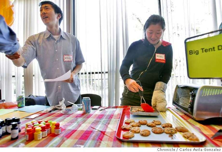 Will Lee and Pearl Wu of Big Tent Design, Inc., brought cookies to draw in students to their expo display at the Start_Up 101 job fair. As part of national entrepreneurship week, a coalition of student groups at Stanford University hosted the largest start-up jobs fair on the West Coast, called Start-Up 101. The jobs fair was held at Tressider Student Union on the Palo Alto, Ca., campus on Thursday, February 28, 2008.  Carlos Avila Gonzalez / San Francisco ChronicleAs part of national entrepreneurship week, a coalition of student groups at Stanford University hosted the largest start-up jobs fair on the West Coast, called Start-Up 101. The jobs fair was held at Tressider Student Union on the Palo Alto, Ca., campus on Thursday, February 28, 2008. Carlos Avila Gonzalez / San Francisco Chronicle Photo: Carlos Avila Gonzalez