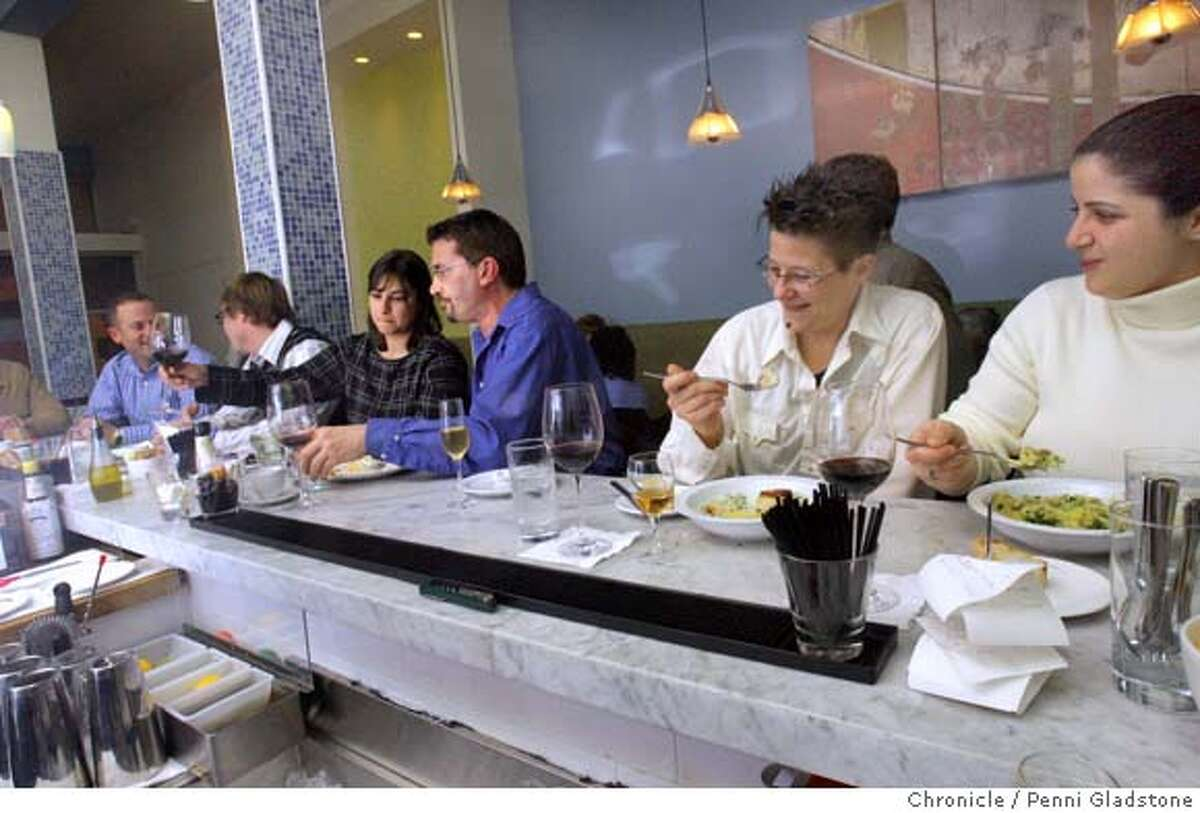 Customers sit at the counter and have dinner Pescheria is a small seafood restaurant, patterened after the small coast-side restaurants in Italy. Event on 1/2/07 in San Francisco. Penni Gladstone / The Chronicle Ran on: 01-21-2007 Creamy polenta is served with Dungeness crab and garlic at San Franciscos Pescheria, a seafood restaurant patterned after Italys coastal restaurants.