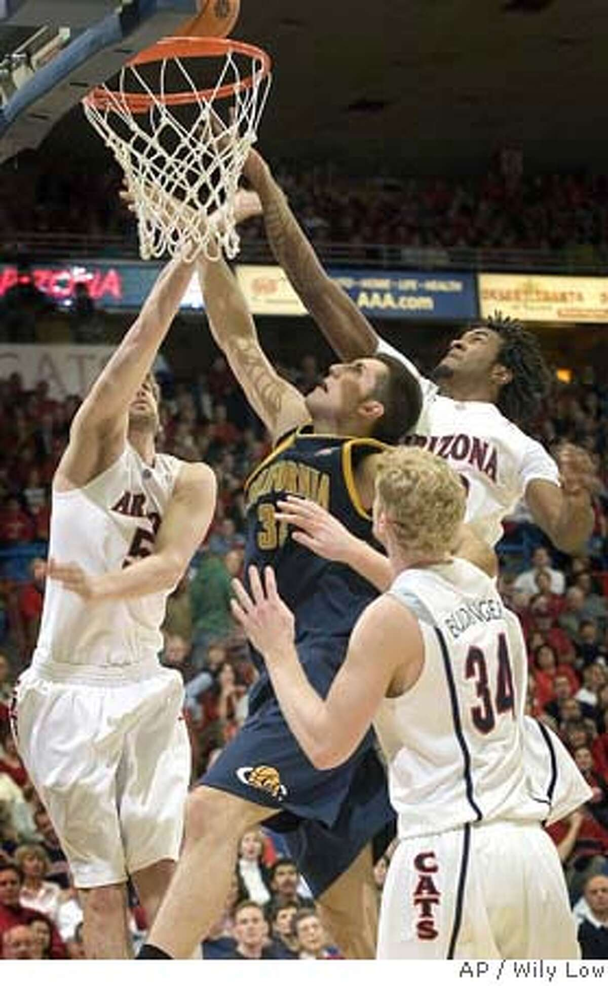 California's Ryan Anderson, center, is surrounded by Arizona's Jordan Hill, right, Chase Budinger (34), and Kirk Walters, left, in the first half of a college basketball game in Tucson, Ariz., Thursday, Feb. 14, 2008. (AP Photo/Wily Low)