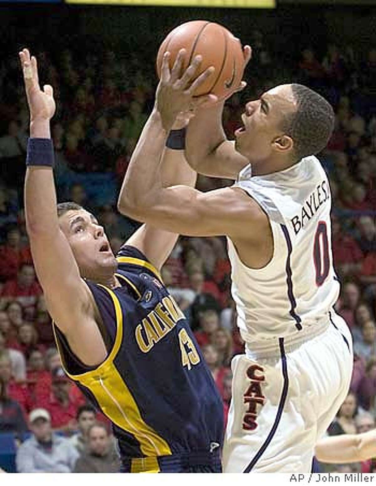 Arizona's Jerryd Bayless (0) shoots over the defense of California's Harper Kamp (43) during the first half of a basketball game in Tucson, Ariz., Thursday, Feb. 14, 2008. (AP Photo/John Miller)