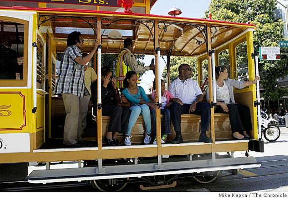 Malia and Sasha Obama ride on the #15 Cable on Washington Street near the Cable Car barn on Monday June 22, 2009 in San Francisco, Calif. Photo: Mike Kepka, The Chronicle