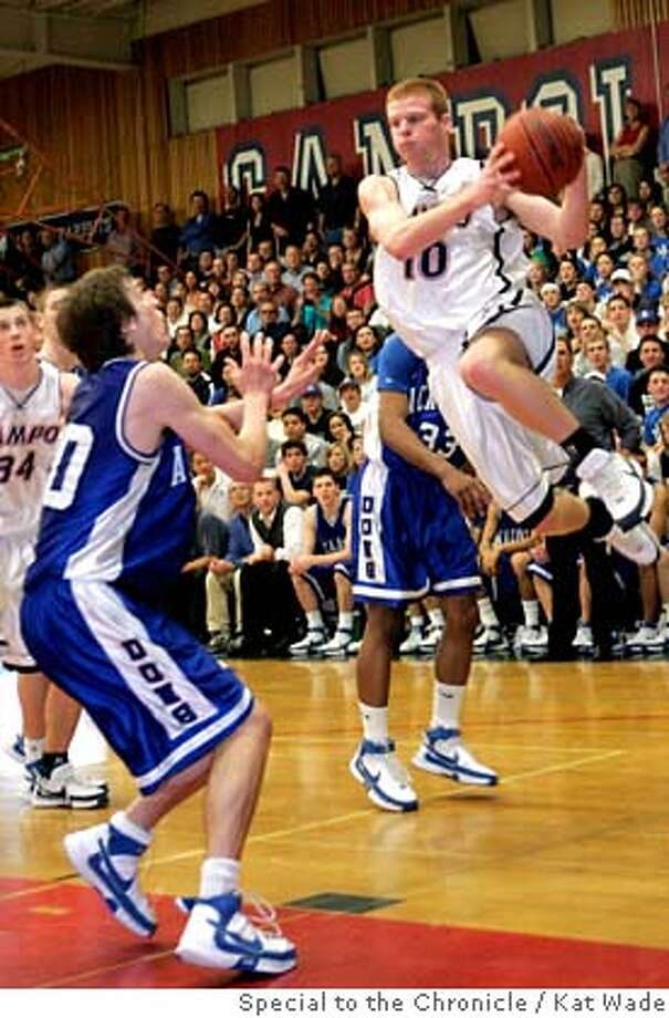 Campolindo Cougars Chris Dyer, right, flies threw the air to pass over Acalanes Dons Joey Anderson leading to a score in the first half when Acalanes plays Campolindo Cougars during the North Coast Section Division iii semifinal at Campolindo High School in Moraga, Calif. on Wednesday, Feb 27, 2008.  Photo by Kat Wade / special to The Chronicle Photo: Kat Wade
