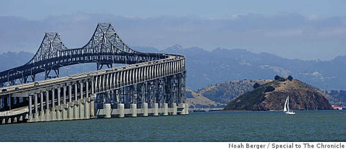 Rock Rock Island, lying to the right of the Richmond-San Rafael Bridge, is pictured in the San Francisco Bay on Sunday, July 5, 2009.