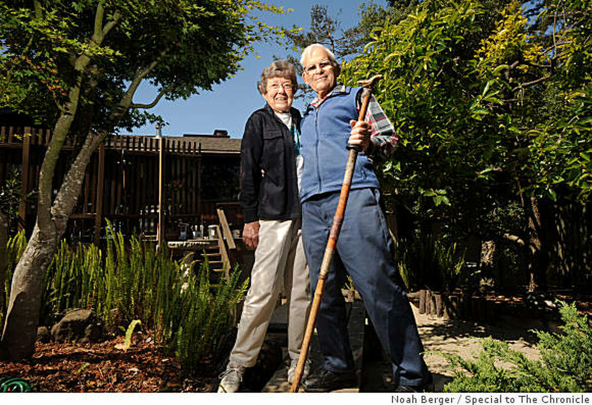 Malcolm and Helen Sowers stand among trees in their Castro Valley, Calif., backyard on Saturday, July 4, 2009. The couple tended to flowers and watered a Monterey Cypress tree on Red Rock Island for decades.
