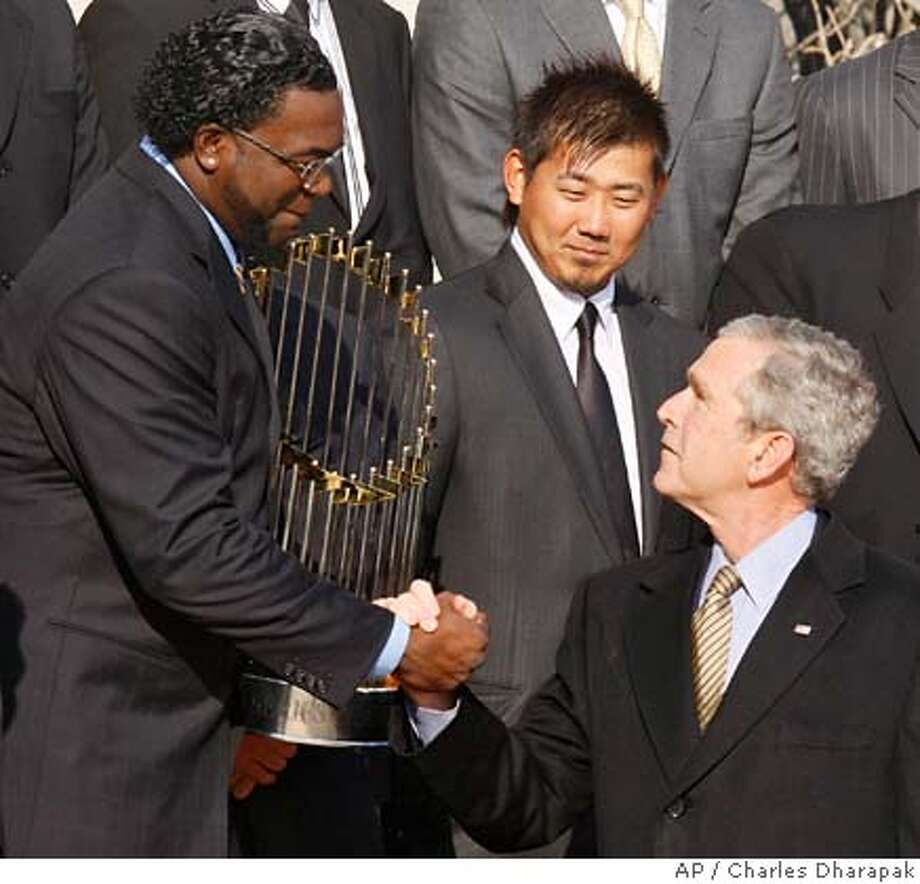 President Bush shakes hands with Boston Red Sox designated hitter David Ortiz as pitcher Daisuke Matsuzaka of Japan, looks on during a ceremony honoring the 2007 World Series champions, Wednesday, Feb. 27, 2008, on the South Lawn of the White House in Washington. (AP Photo/Charles Dharapak) Photo: Charles Dharapak