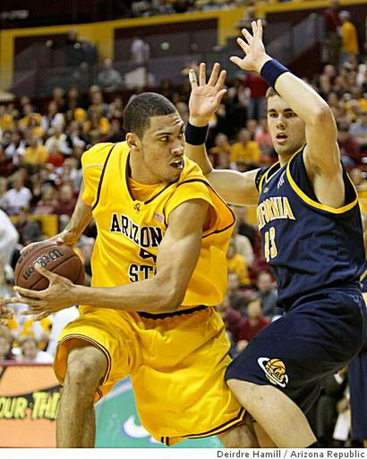 ASU #4 Jeff Pendergraph, cq, left, cq, looks to pass against California #43 Harper Kamp, cq, at Wells Fargo Arena, in Tempe.Photo by Deirdre Hamill /The Arizona Republic