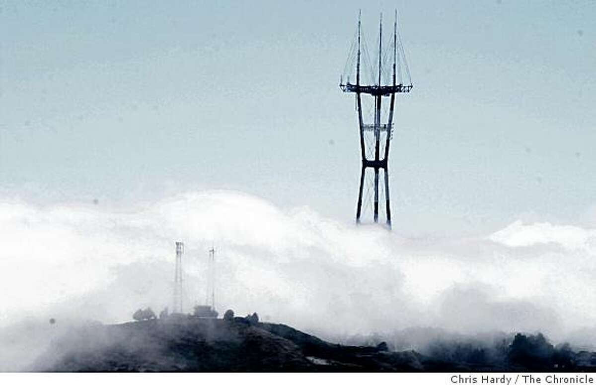 FOG COMES INTO THE CITY OVER TWIN PEAKS AND SUTRO TOWER