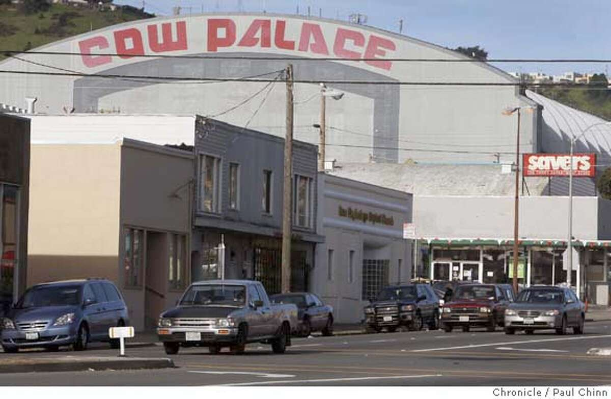The Cow Palace rises above smaller businesses on Geneva Avenue in Daly City, Calif., on Wednesday, Feb. 27, 2008. State senator Leland Yee is proposing that the state of California, which owns the property, should sell it to the city of Daly City which in turn would raze the historic structure and build a shopping center and residential units. Photo by Paul Chinn / San Francisco Chronicle