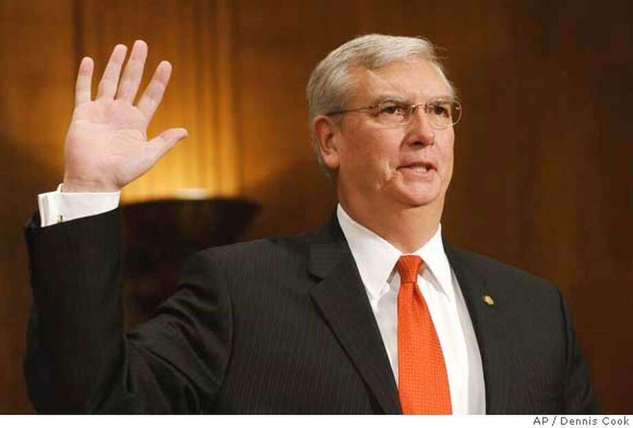 Environmental Protection Agency (EPA) Administrator Stephen Johnson is sworn in on Capitol Hill in Washington, Thursday, Jan. 24, 2008, prior to testifying before the Senate Environment and Public Works Committee's hearing on California' request for a greenhouse gas waiver. (AP Photo/Dennis Cook) Photo: Dennis Cook