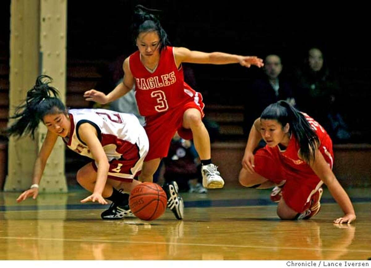 Lowell high school guard Kristina Lum (left) battles Washington High Rachelle Hwee #3 and Brittany Woo over the ball in Washington's side of the court during second period AAA girls basketball action at Kezar Pavilion, in San Francisco Tuesday night February 26, 2008 photo By Lance Iversen / San Francisco Chronicle. MANDATORY CREDIT PHOTOG AND SAN FRANCISCO CHRONICLE/NO SALES MAGS OUT