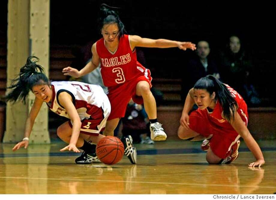 Lowell high school guard Kristina Lum (left) battles Washington High Rachelle Hwee #3 and Brittany Woo over the ball in Washington's side of the court during second period AAA girls basketball action at Kezar Pavilion, in San Francisco Tuesday night February 26, 2008 photo By Lance Iversen / San Francisco Chronicle. MANDATORY CREDIT PHOTOG AND SAN FRANCISCO CHRONICLE/NO SALES MAGS OUT Photo: Lance Iversen