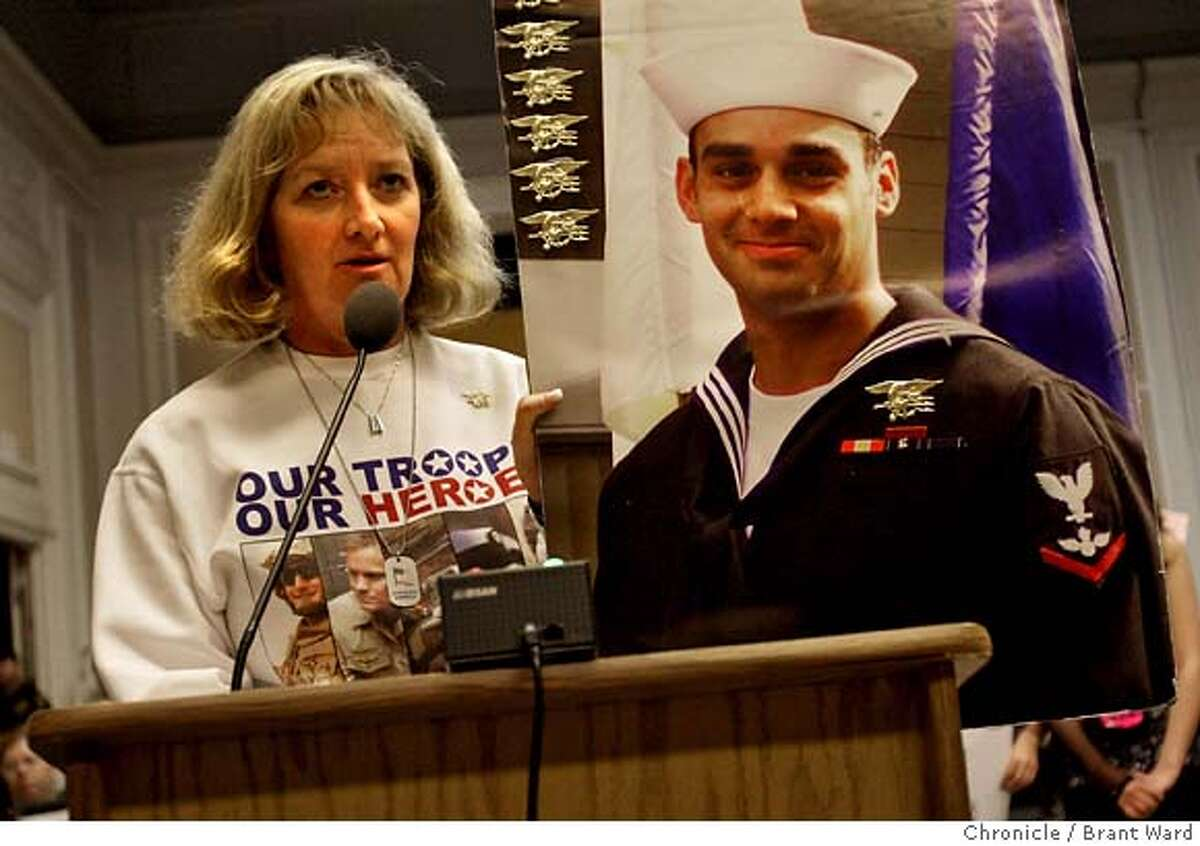 Debbie Lee held a picture of her son, Marc Alan Lee, who was the first Navy Seal killed in Iraq. She condemned the stand by the council. Citizens stood up at the City Council meeting in Berkeley to try to convince the decision by the council. (Photo by Brant Ward/San Francisco Chronicle)