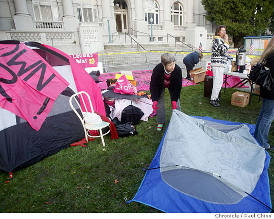 Anti-war protesters camped in front of City Hall. Anti-war and pro-military demonstrators protest at Civic Center Plaza in Berkeley, Calif. on Tuesday, Feb. 12, 2008 before tonight's City Council meeting on the Marine Corps recruitment center downtown.  PAUL CHINN/San Francisco Chronicle Photo: PAUL CHINN