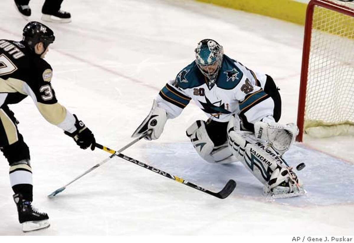 San Jose Sharks goalie Evgeni Nabokov , right,of Kazakhstan, can't stop a backhand shot by Pittsburgh Penguins' Jarkko Ruutu during a shootout in NHL hockey action in Pittsburgh Sunday, Feb. 24, 2008 in Pittsburgh. The Sharks won the game, 2-1, on a shootout goal by Jeremy Roenick.(AP Photo/Gene J. Puskar) EFE OUT