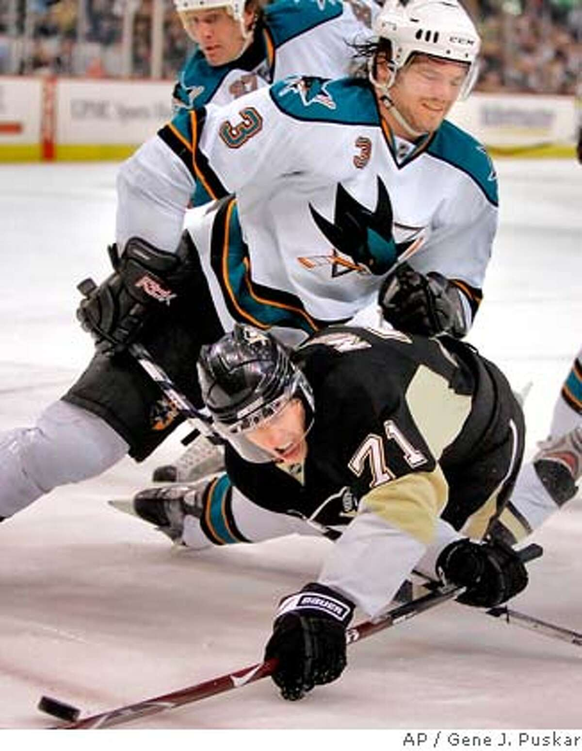 San Jose Sharks' Douglas Murray (3), of Sweden, gets tangled with Pittsburgh Penguins' Evgeni Malkin (71), of Russia, in the first period of NHL hockey action in Pittsburgh, Sunday, Feb. 24, 2008 in Pittsburgh.