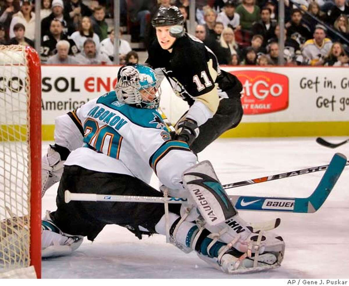 San Jose Sharks goalie Evgeni Nabokov , left, of Kazakhstan, deflects a first period shot by Pittsburgh Penguins' Jordan Staal (11) in the first period of NHL hockey action in Pittsburgh Sunday, Feb. 24, 2008, in Pittsburgh. (AP Photo/Gene J. Puskar)