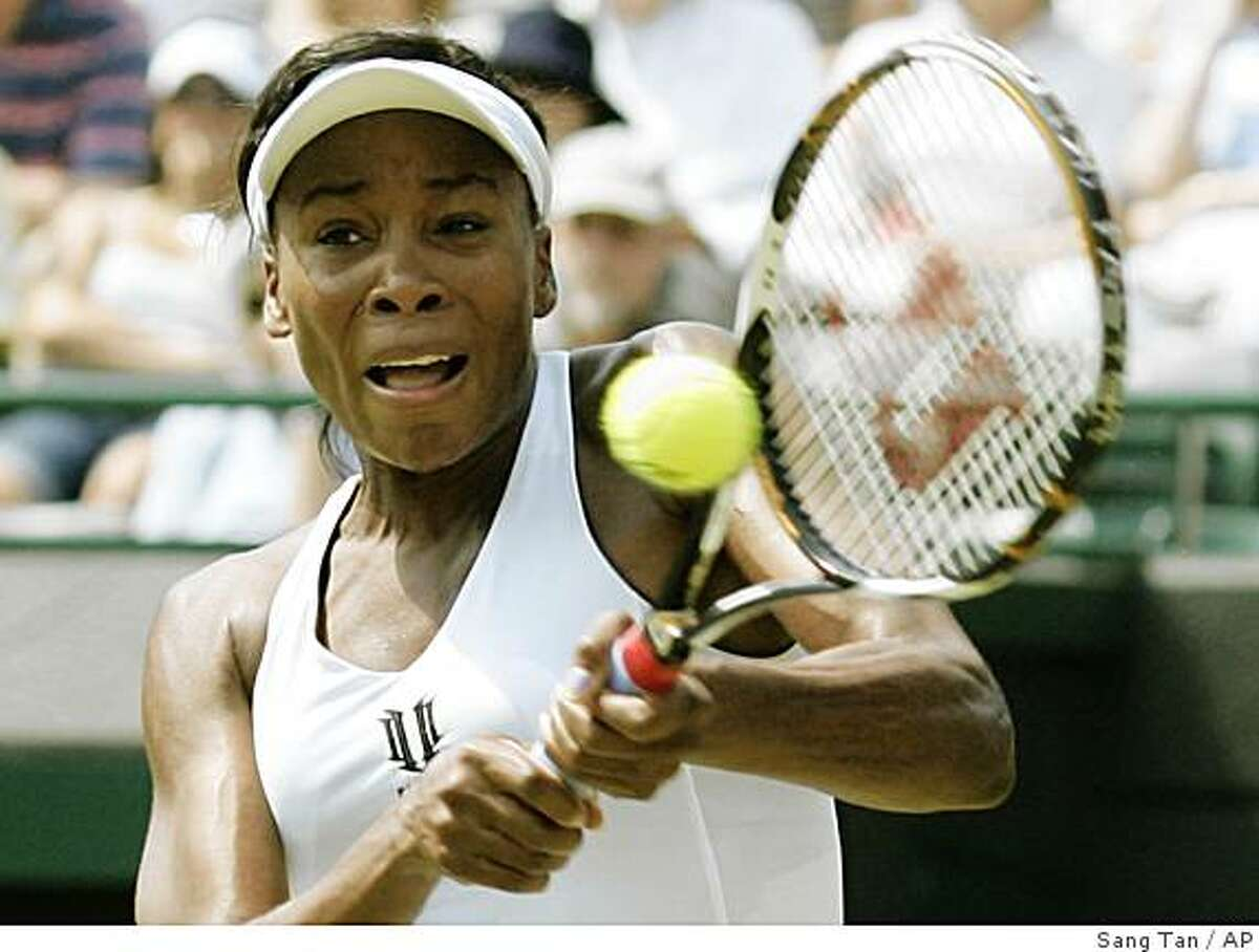 Venus Williams of U.S. returns to Kateryna Bondarenko of Ukraine, during their second round women's singles match at Wimbledon, Thursday, June 25, 2009. (AP Photo/Sang Tan)