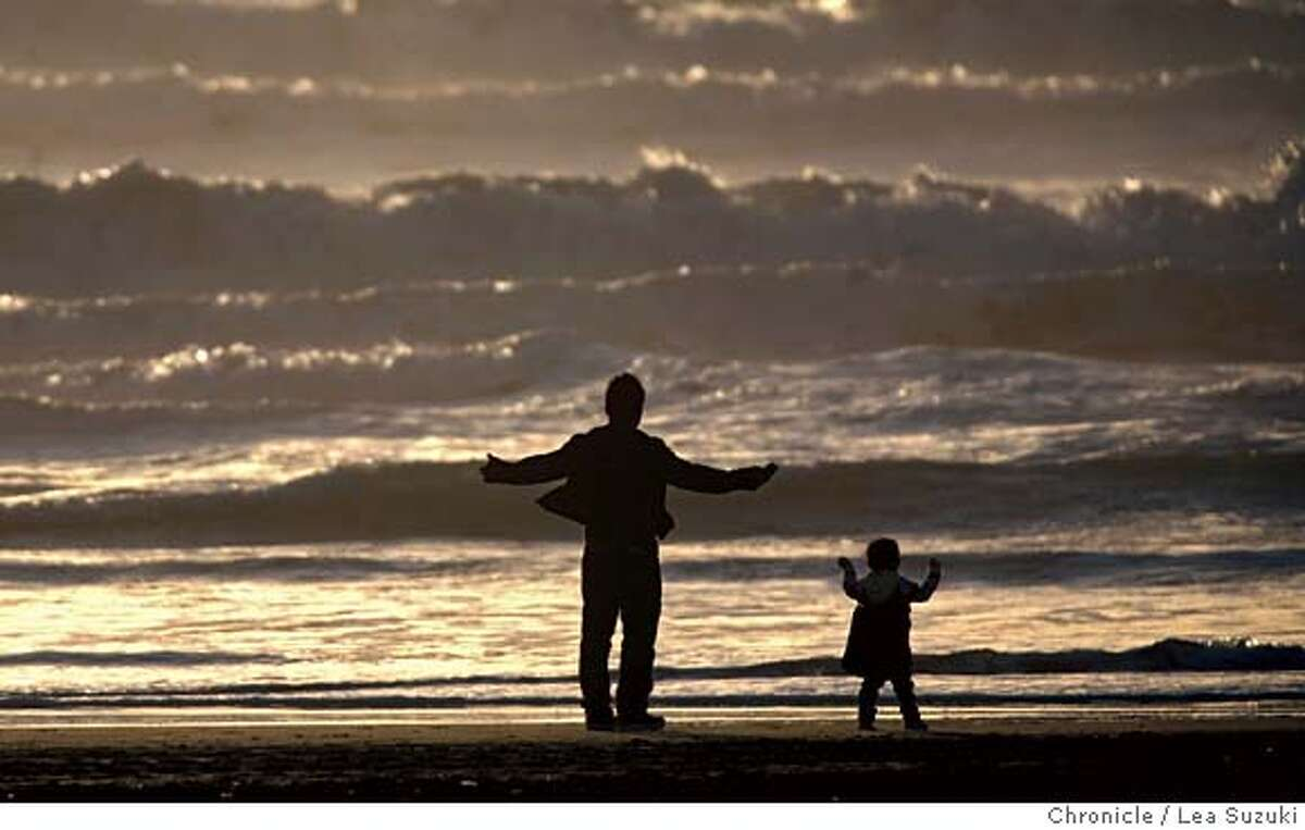 From left: Johann and Joey Camat of South San Francisco take in the view of the ocean at Ocean Beach. Johann had asked his daughter Joey what she would like to do on his day off and she told him she wanted to see water. Photo by Lea Suzuki / San Francisco Chronicle