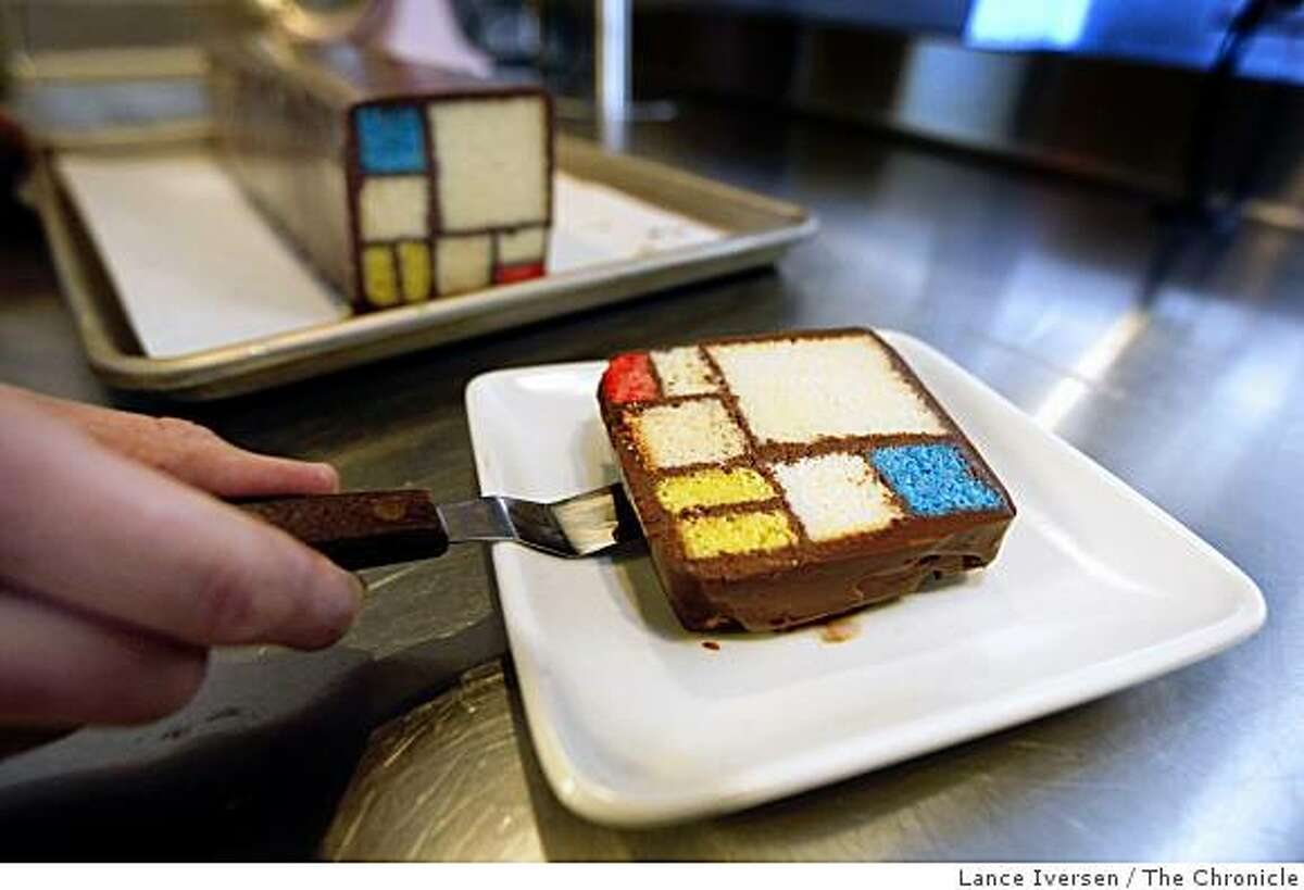 Caitlin Freeman, the pastry chef for the new SFMOMA rooftop garden cafe, plates up a slice of Mondrian cake, inspired by a painting by Piet Mondrian dated 1935-1942 titled Composition with Red, Yellow and Blue June 16, 2009.