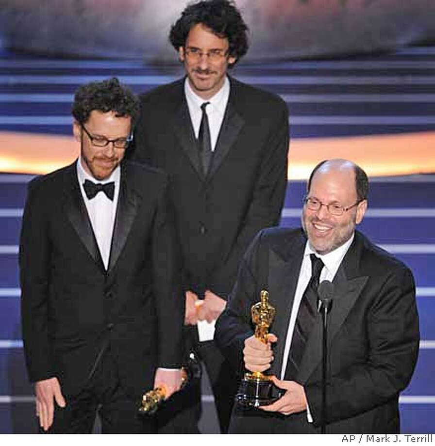 "Producers Scott Rudin, right, Ethan Coen, left, and Joel Coen accept the Oscar after the film ""No Country for Old Men"" won best motion picture of the year at the 80th Academy Awards Sunday, Feb. 24, 2008, in Los Angeles. (AP Photo/Mark J. Terrill) Photo: Mark J. Terrill"